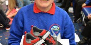 Schoolboy's eye-catching design wins free shoes for 30 classmates